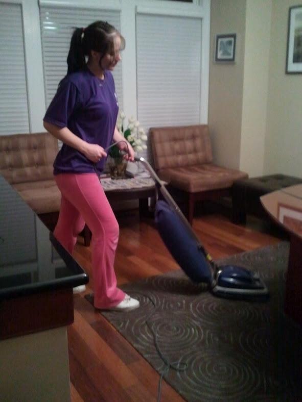 Thai Cleaning Service team member vacuuming the carpet